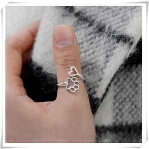 Silver open adjustable ring with paw motif NWOT